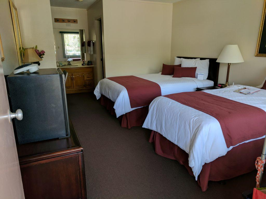 motel room at Lake Yale showing two double beds.  In the back of the room, the sink and mirror are visible.