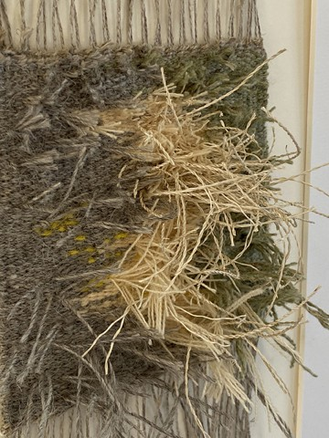 close up showing handwoven piece with wild grass is an example of texture in tapestry