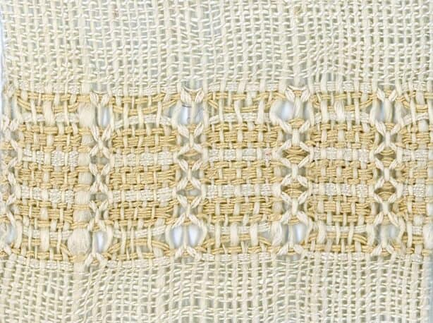 detail of Esthers Lace handwoven fabric is an example of doup leno